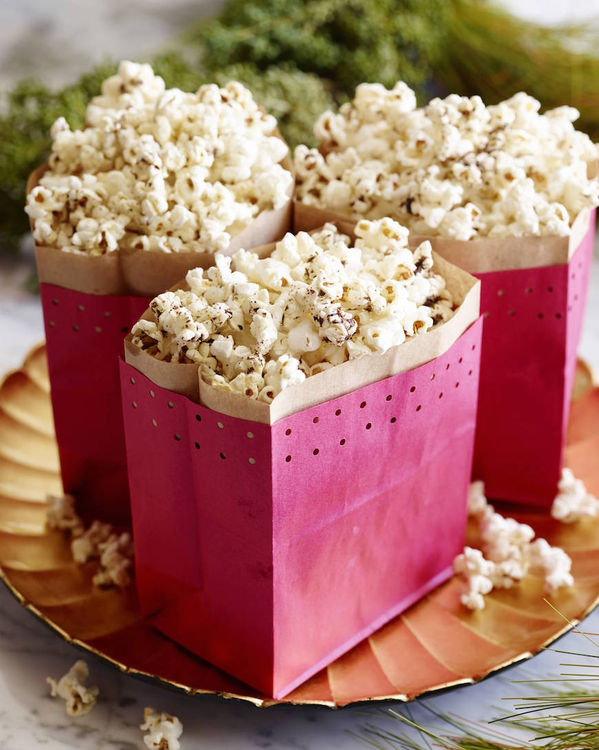 Whip up this super easy recipe for Parmesan Herb Spiced Popcorn for a savory snack any time of the year! It's seriously more addicting than Kettle Corn.
